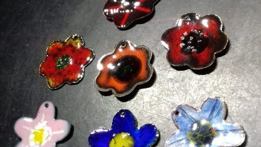 enamelled copper flower pendants just out of the kiln